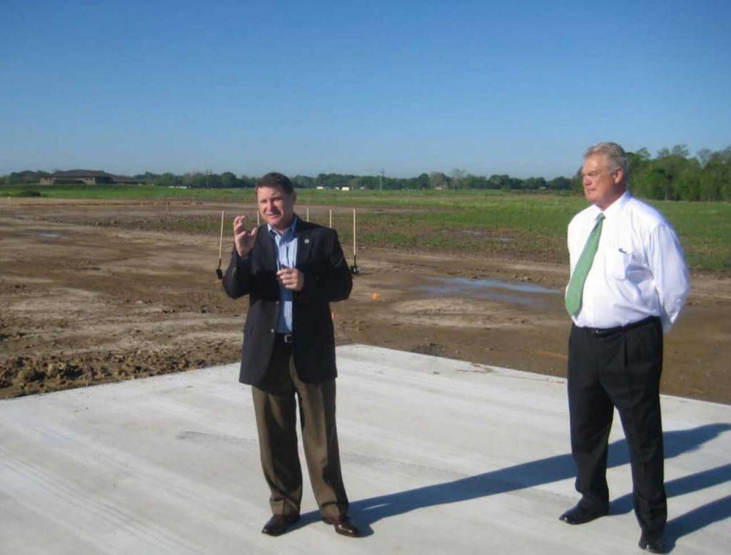Louisiana Senator Page Cortez, left, addresses the gathering, with Eric Rosen looking on.